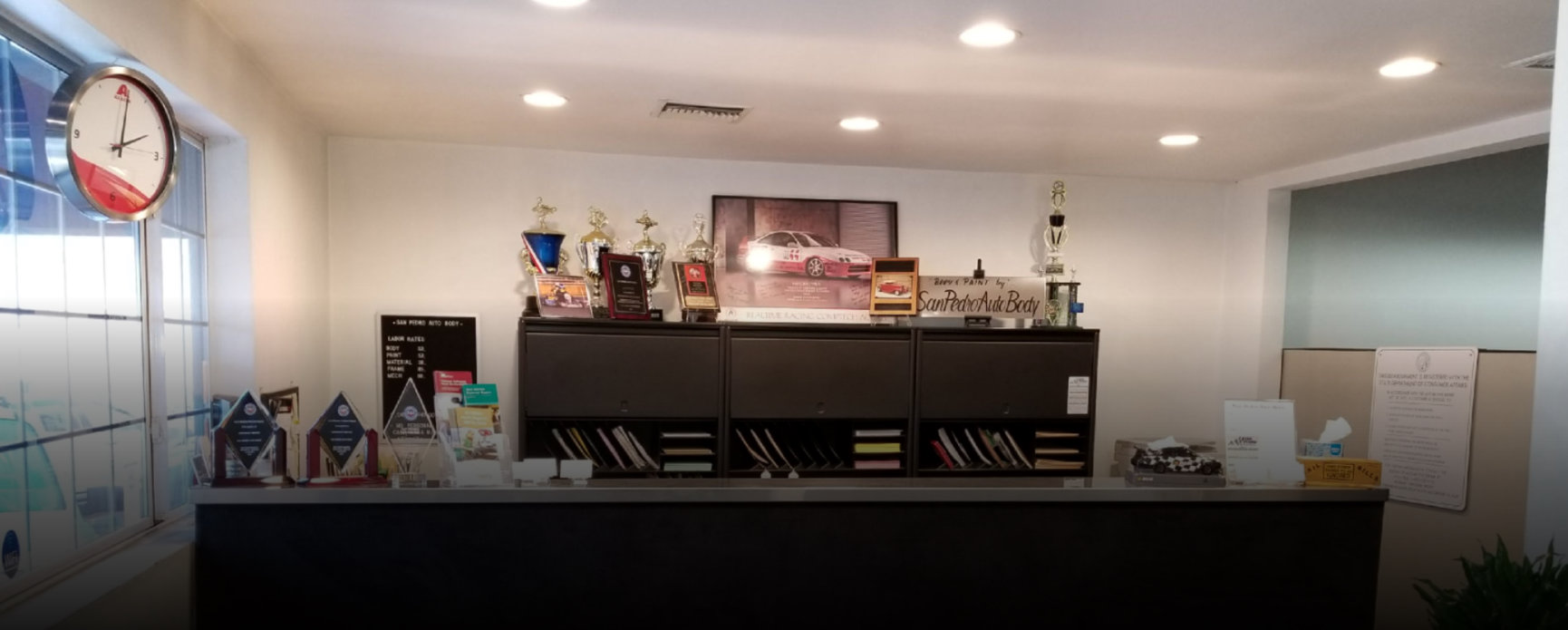 portrait of office with trophies