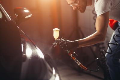 coating business with ceramic coating.Spraying varnish to car